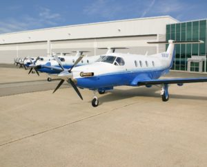 Aircraft lined up outside hangar
