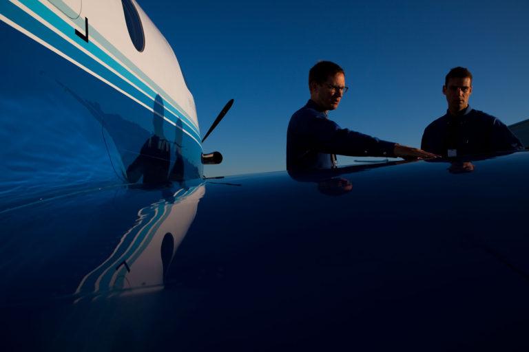 Pilots near plane wing PlaneSense pilot jobs