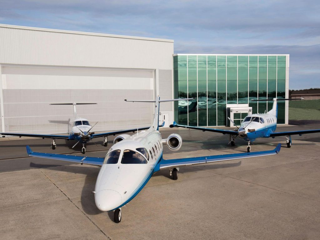 Three Pilatus aircraft stationed outside PlaneSense headquarters in Portsmouth, NH