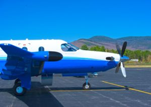 Pilatus PC-12 parked side view