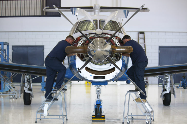 aviation jobs like aircraft mechanics working on a Pilatus plane