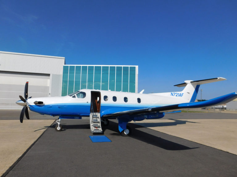 Pilatus PC 12 fractional ownership program aircraft parked on the tarmac