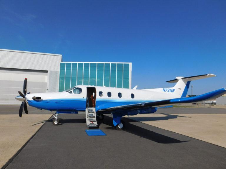 Pilatus PC 12 fractional ownership program aircraft parked on the tarmac
