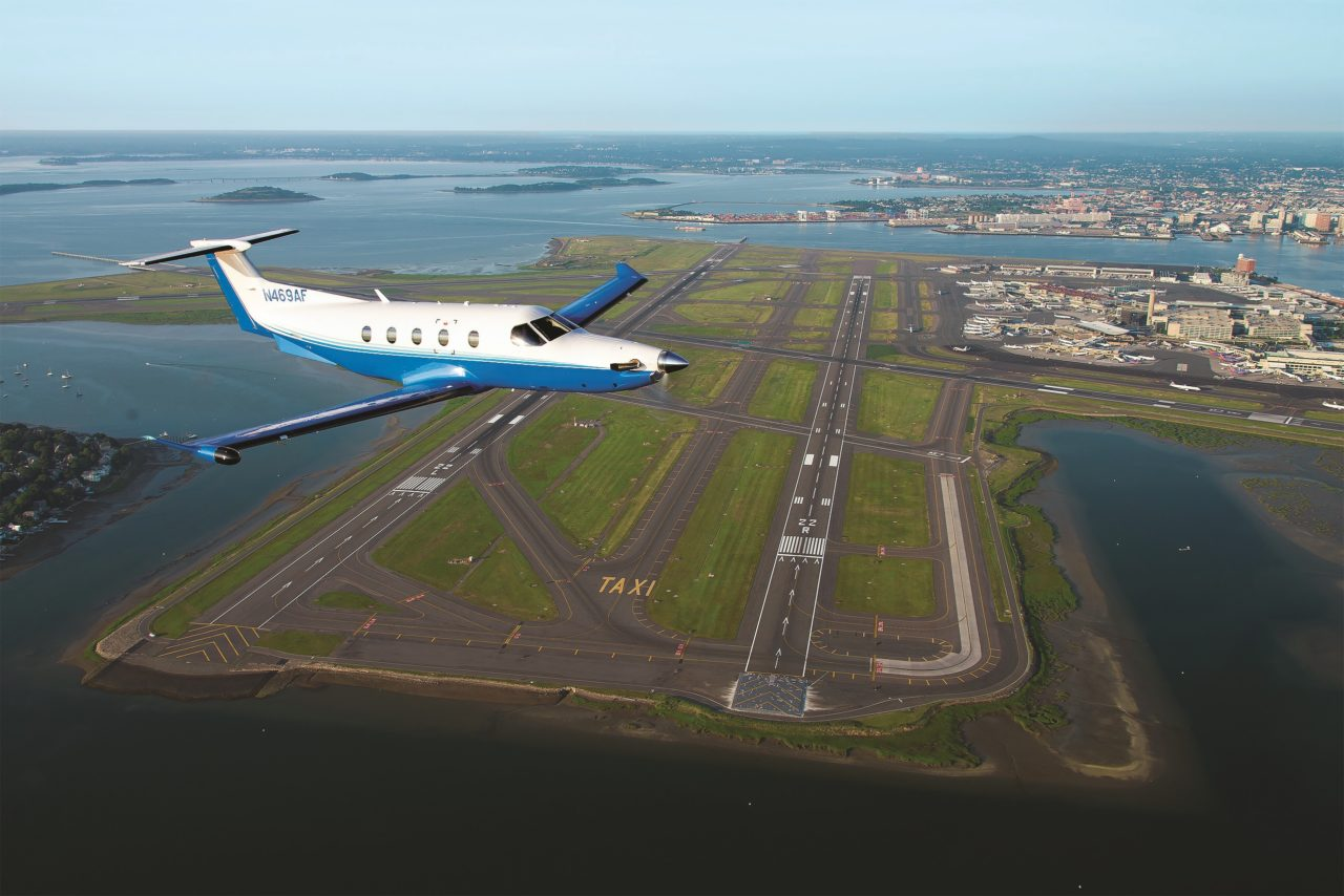 PlaneSense PC-12 flying over Boston.
