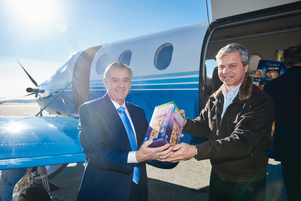 Tom Blonski and George Antoniadis help unload food donations.