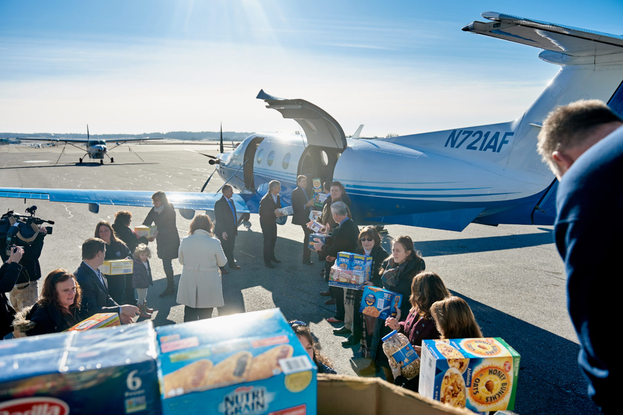 Loading a PlaneSense PC-12 with donations for NH Food Bank