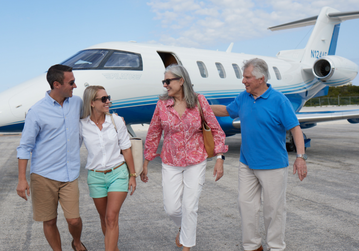 Family on vacation after traveling on PlaneSense PC-24 Jet