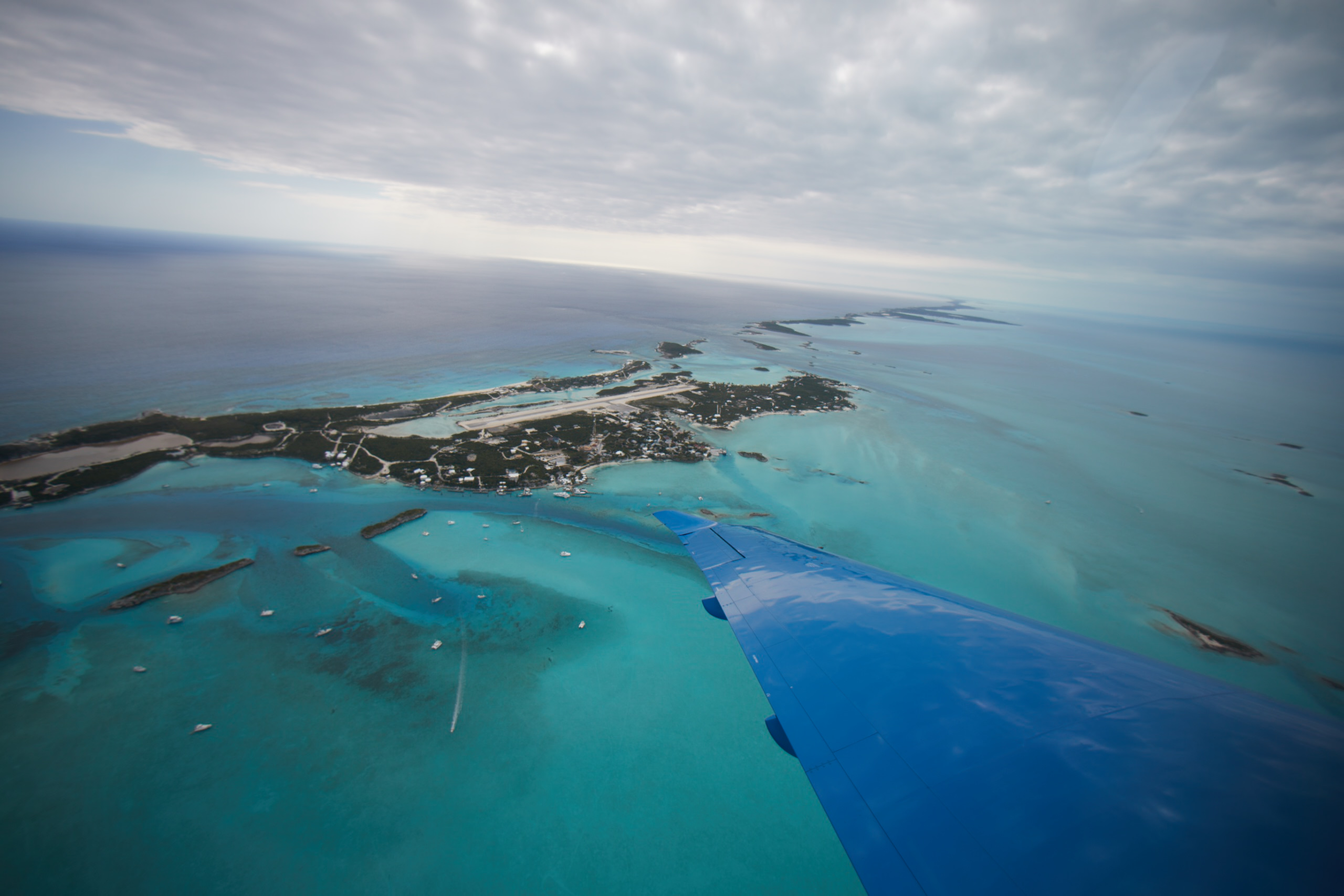 Wing View of Staniel Cay from a Pilatus PC-24 Private Jet