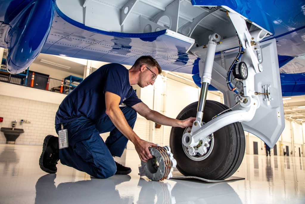 Atlas Aircraft Center Mechanic Repairing Plane
