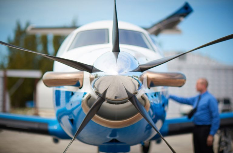 A person and a Pilatus PC-12 airplane